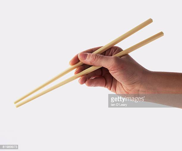 Person holding chopsticks