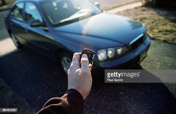 Person holding electronic key by car