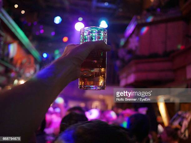 Person Holding Glass Of Beer In Night Club
