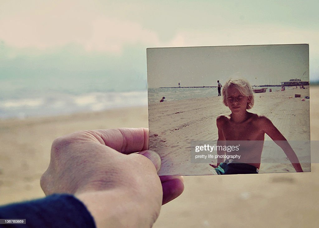 Person holding old picture : Stock Photo