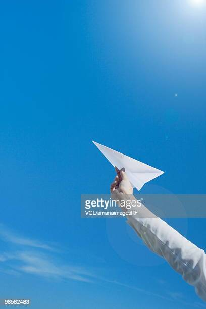 Person holding paper airplane