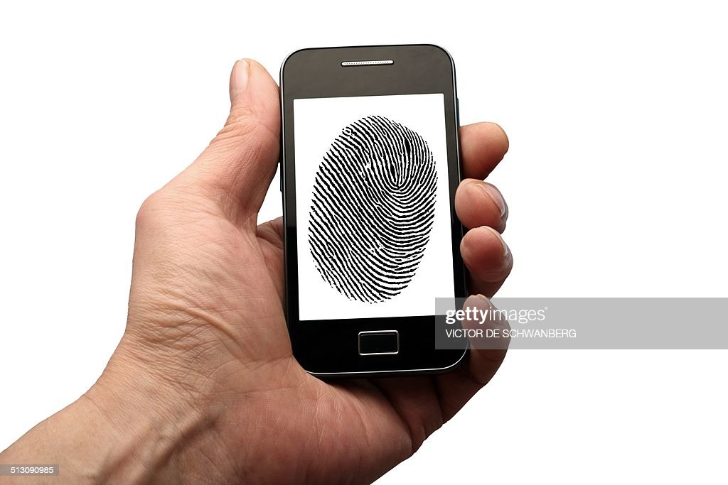 Person holding phone with finger print