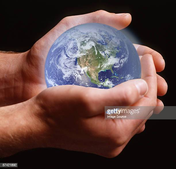 Person holding planet earth