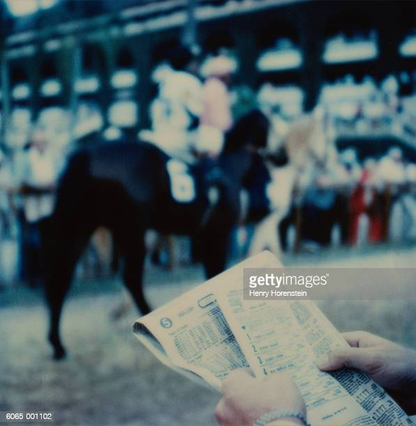 Person Holding Racing Form