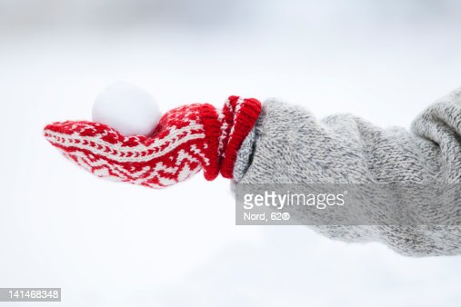 Person holding snowball