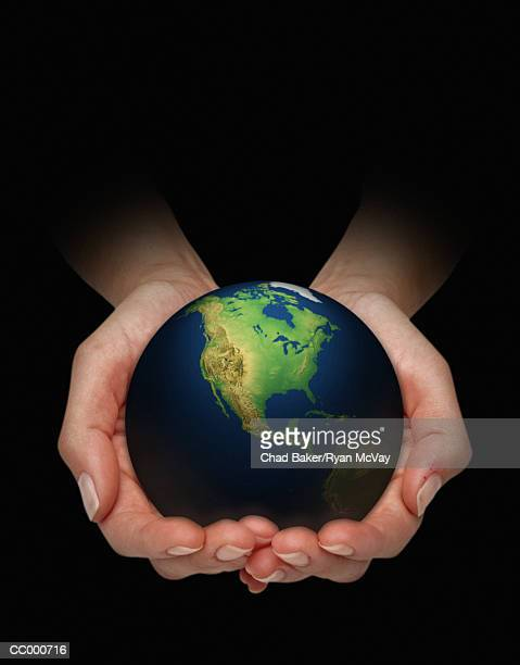 Person Holding the Earth in Their Hands
