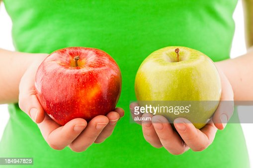 A person holding two apples in their hands