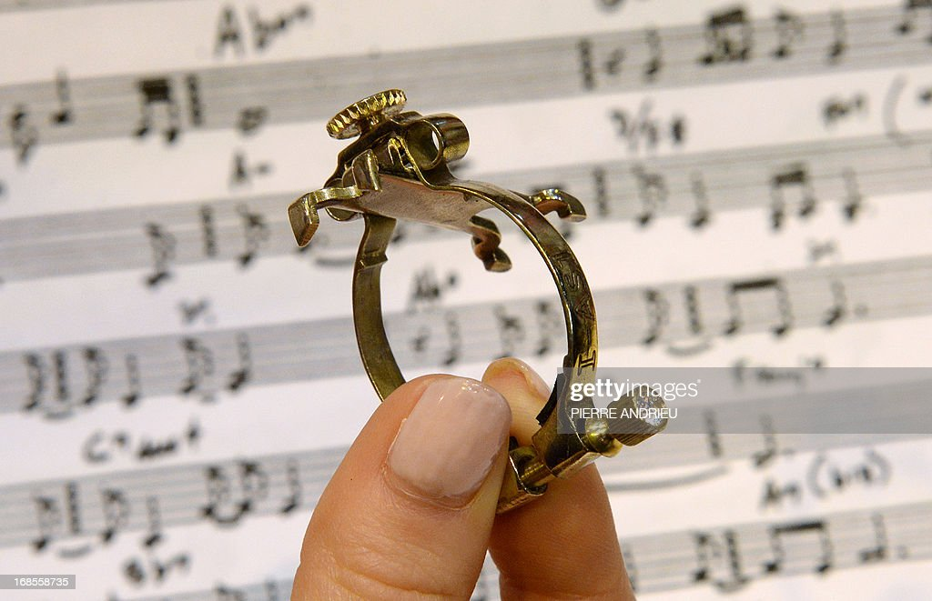 A person holds a brass ligature aimed at adjusting the reed of a saxophone or a clarinet in order to preserve the sound, an invention by Jean-Luc Vignaud, winner of the 2013 Concours Lepine (Lepine contest) during the Paris' Fair at the Porte de Versailles exhibition hall in Paris, on May 11, 2013. The competition was launched in 1901 by Louis Lepine, the city's police chief. ANDRIEU