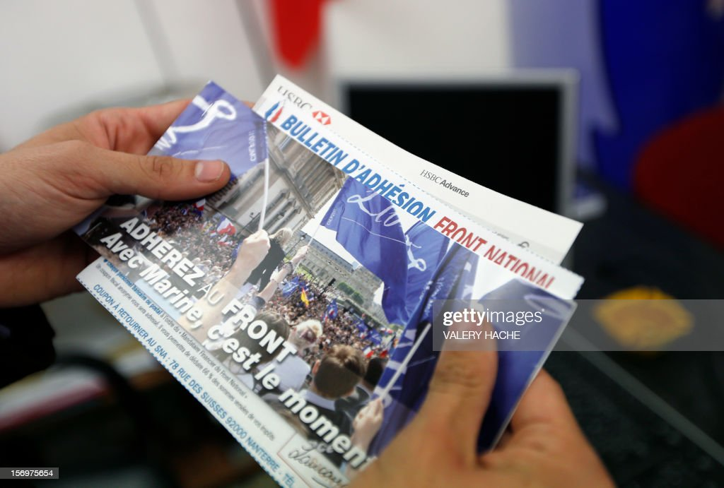 A person holds a bulletin of adhesion for the Front national far-right party on November 26, 2012 in Nice. AFP PHOTO / VALERY HACHE