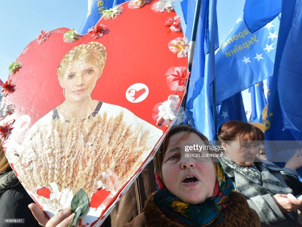 A person holds a heart shaped placard bearing a picture of jailed former Prime minister Yulia Tymoshenko during a rally called by Ukrainian opposition 'against political repression!' on Independence square in Kiev on February 25, 2012, on the day of the start of the 16th Ukraine-European Union summit in Brussels.
