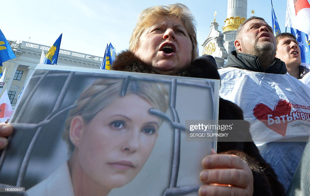 A person holds a placard bearing a picture of jailed former Prime minister Yulia Tymoshenko during a rally called by Ukrainian opposition 'against political repression!' on Independence square in Kiev on February 25, 2012, on the day of the start of the 16th Ukraine-European Union summit in Brussels. AFP PHOTO/ SERGEI SUPINSKY