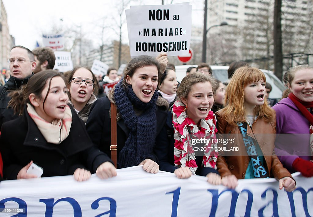 A person holds a placard reading 'No to homosexual marriage' during a protest organized by fundamentalist Christians group Civitas Institute against same-sex marriage on January 13, 2013 in Paris. Tens of thousands march in Paris on January 13 to denounce government plans to legalise same-sex marriage and adoption which have angered many Catholics and Muslims, France's two main faiths, as well as the right-wing opposition. The French parliament is to debate the bill -- one of the key electoral pledges of Socialist President -- at the end of this month. AFP PHOTO / KENZO TRIBOUILLARD