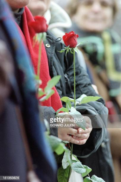 A person holds a rose for the memorial service dedicated to the late French President Francois Mitterrand at Paris' Notre Dame cathedral on January...