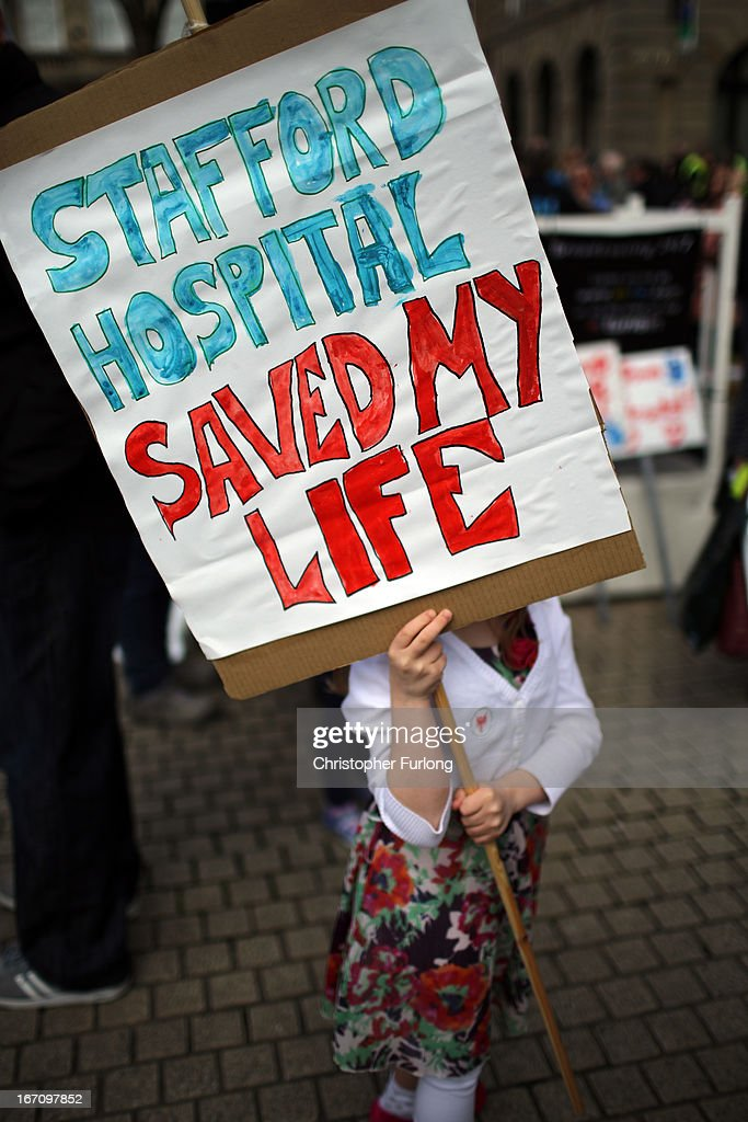A person holds a sign as campaigners take to the streets of Stafford as they demonstrate to keep major health services at the scandal hit Stafford Hospital on April 20, 2013 in Stafford, England. The march was organised by the Support Stafford Hospital campaign group who are fighting cuts to major health services at the hospital. The Health regulator monitor has appointed two special administrators to produce a plan for the reorganisation of future services.
