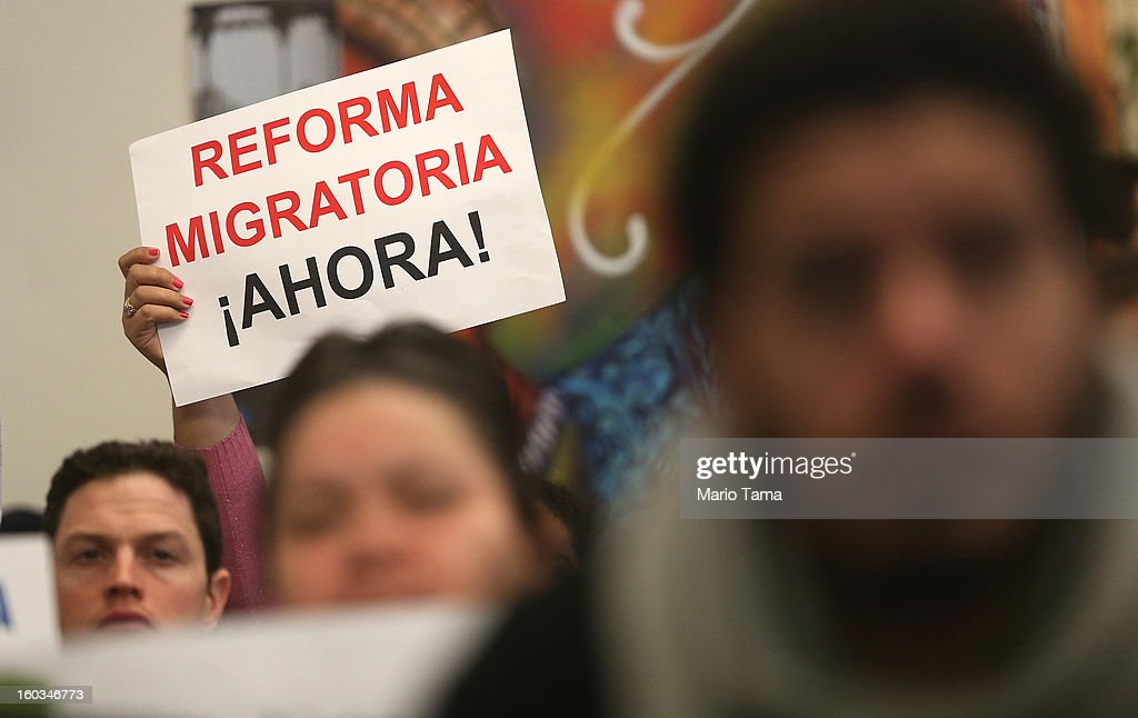 A person holds a sign written in Spanish reading 'Immigration Reform Now' during a watch party of President Barack Obama's speech on immigration on January 29, 2013 in the Queens borough of New York City. Obama called for immigration reform and a 'pathway to citizenship' for the nation's 11 million undocumented immigrants.