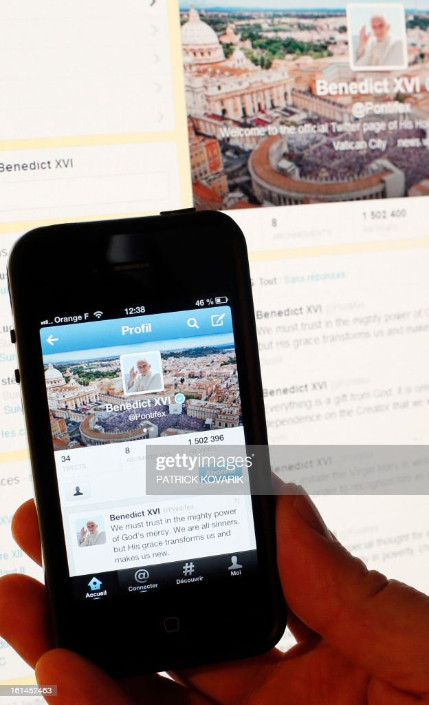 A person holds a smartphone displaying the twitter account of pope Benedict XVI, on February 11, 2013 in Paris. Pope Benedict XVI announced on February 28, he will resign as leader of the world's 1.1 billion Catholics because his age prevented him from carrying out his duties -- an unprecedented move in the modern history of the Catholic Church.