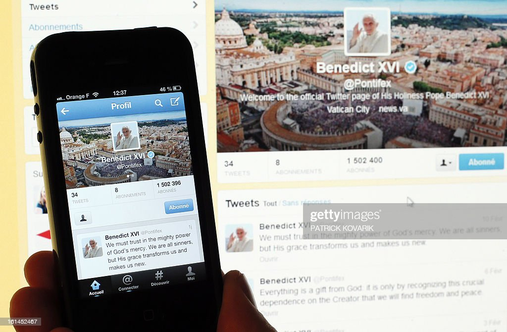 A person holds a smartphone displaying the twitter account of pope Benedict XVI, on February 11, 2013 in Paris. Pope Benedict XVI announced on February 28, he will resign as leader of the world's 1.1 billion Catholics because his age prevented him from carrying out his duties -- an unprecedented move in the modern history of the Catholic Church. AFP PHOTO PATRICK KOVARIK