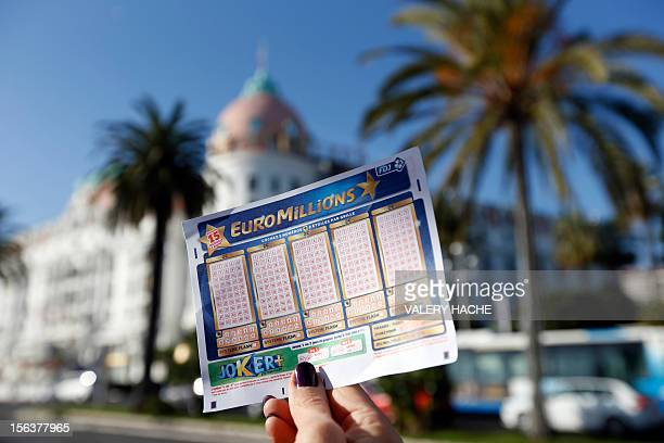 A person holds an Euromillions lottery ticket on november 14 2012 in Nice A lucky punter beat the French record for a Euromillions lottery today...
