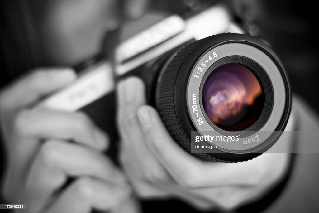 Person holds camera : Stock Photo