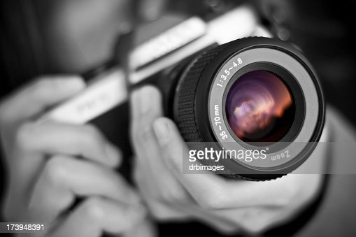 Person holds camera