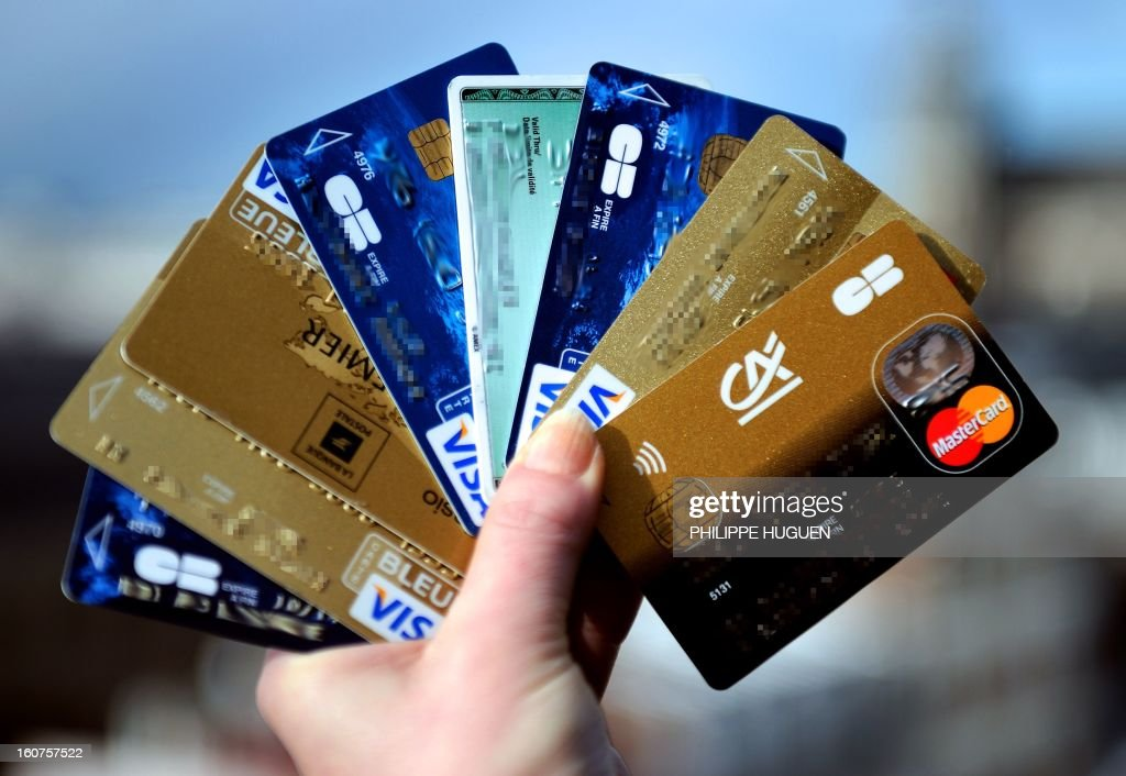 A person holds credit cards on February 5, 2013 in Lille. French police has arrested, early this morning in Paris and in several French and overseas departments, 22 people in connection with the trade of credit cards numbers on internet.