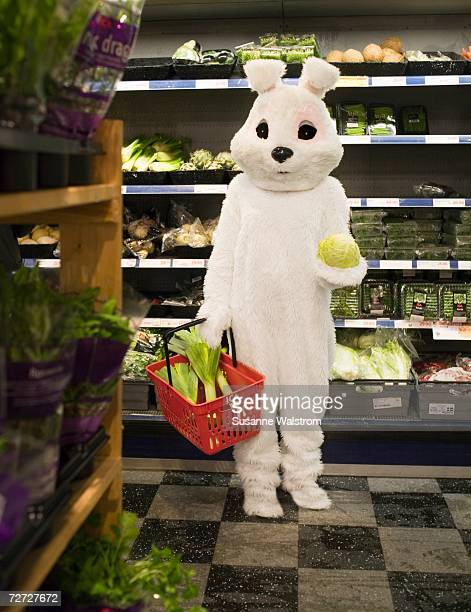 A person in a bunny costume shopping.