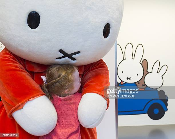 A person in a Nijntje costume hugs a child during the official reopening of the 'Nijntje Museum' in Utrecht on February 5 2016 Miffy is a small...