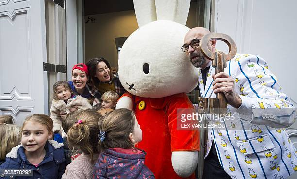A person in a Nijntje costume poses with children during the official reopening of the 'Nijntje Museum' in Utrecht on February 5 2016 Miffy is a...