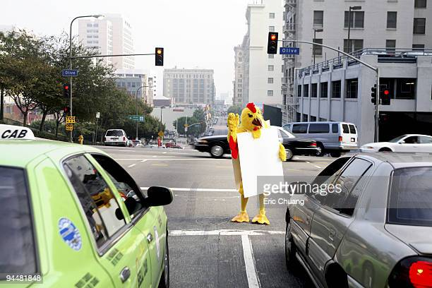 Person in chicken costume at crosswalk