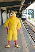 Person in chicken costume waiting for train