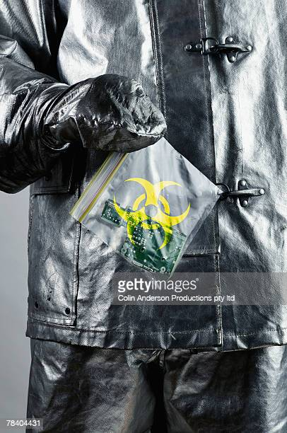 Person in hazardous materials suit with biohazard