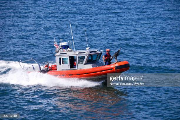 Person In Lifeboat On Sea