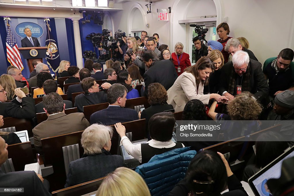 A person in need of medical attention is tended to as U.S. President Barack Obama answers questions during a news conference in the Brady Press Breifing Room at the White House December 16, 2016 in Washington, DC. In what could be the last press conference of his presidency, afterwards Obama will be leaving for his annual family vacation in Hawaii.