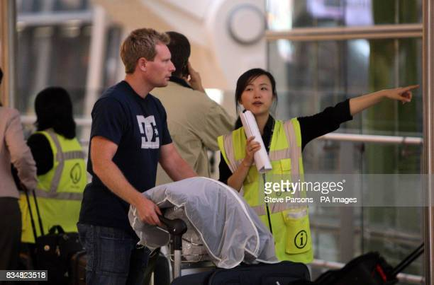 A person is directed in Terminal 5 of Heathrow Airport London after a glitch in the air traffic control system caused scores of flights to be...