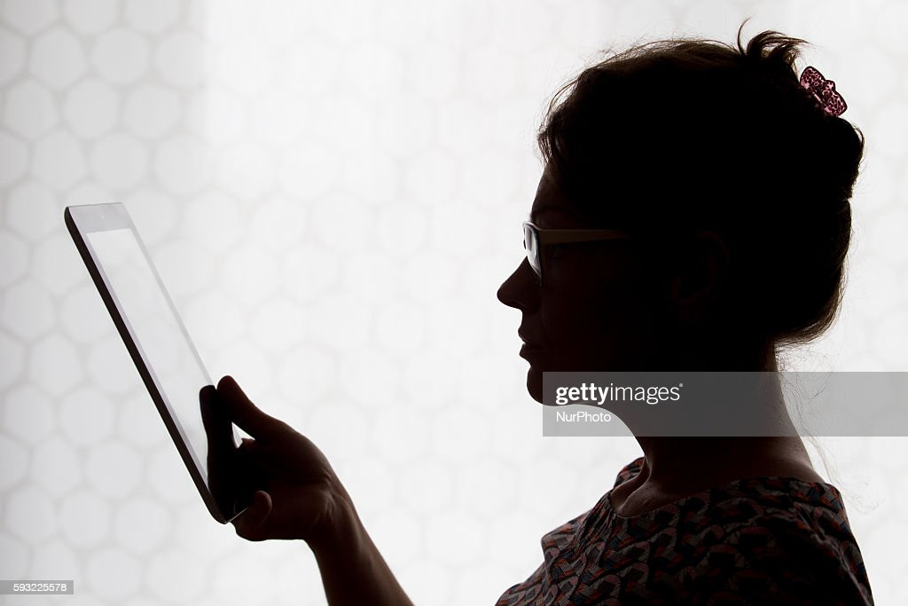 A person is seen using the Twitter app on a tablet in Bydgoszcz, Poland on August 21 2016.