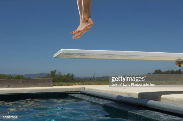 Person jumping on the diving board