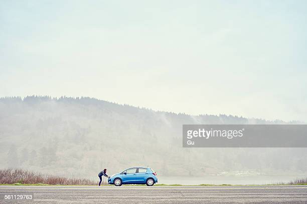 Person leaning on car, Trinidad, California, USA