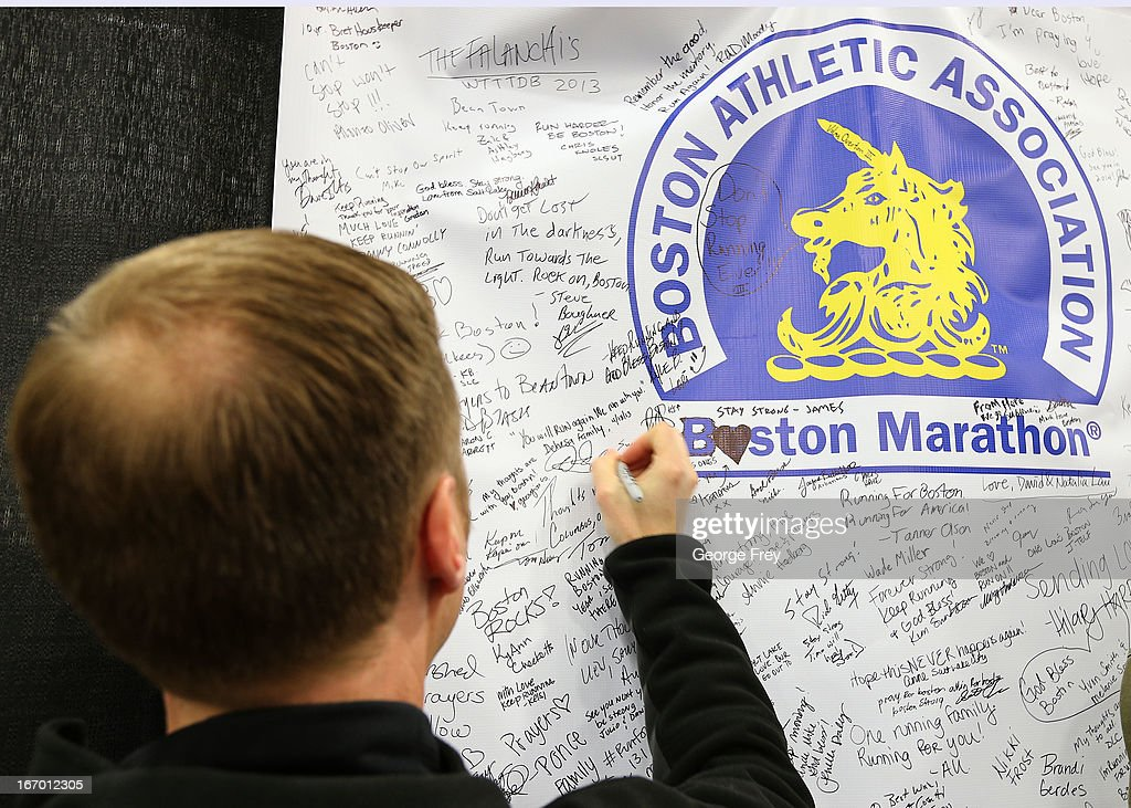 A person leaves a message on a large banner for the victims of the Boston Marathon bombing, at the race headquarters of the Salt Lake City Marathon, April, 19, 2013 in Salt Lake City, Utah. The Salt Lake City Marathon is going to be run tomorrow, April 20, 2013 and will be the first major marathon in the U.S. since the Boston Marathon Bombing. Police officials have said security has been dramatically increased since the Boston bombing and is at some the highest levels since the city hosted the 2002 Olympics.