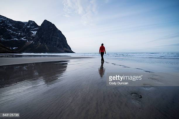 Person leaves footpints in sand at scenic Kvalvika beach, Moskenesoy, Lofoten Islands, Norway