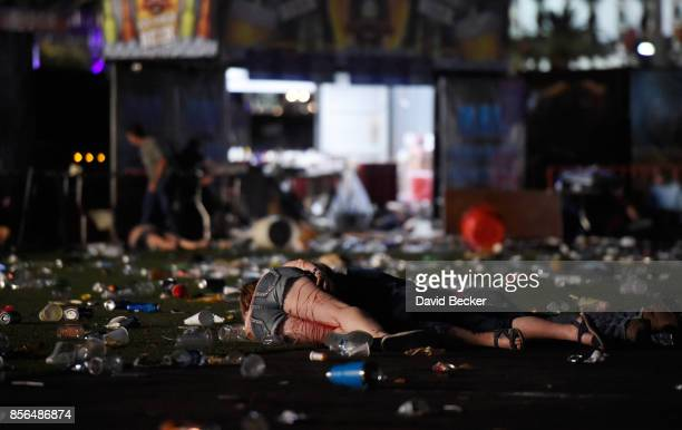 A person lies on the ground covered with blood at the Route 91 Harvest country music festival after apparent gun fire was heard on October 1 2017 in...