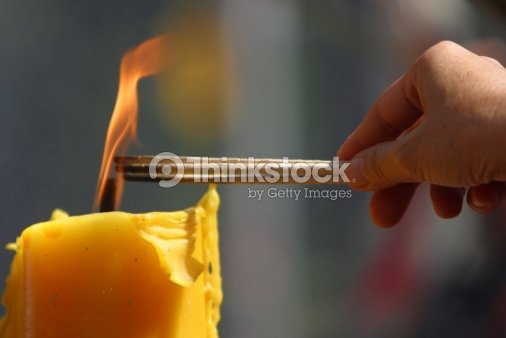 Person lighting incense : Stock Photo