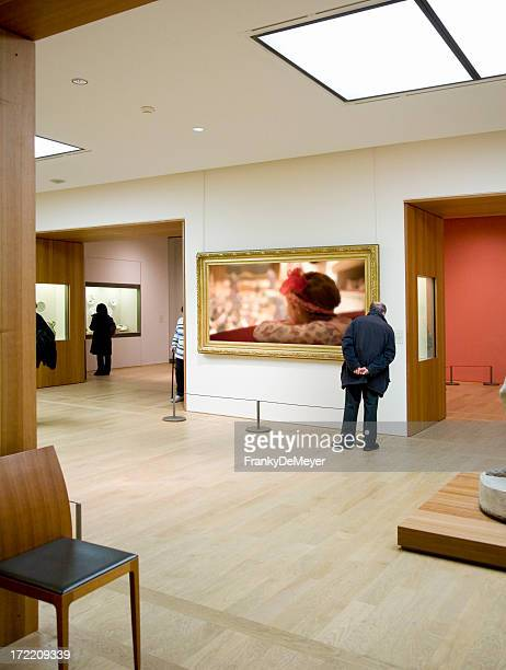 Person looking at art in an art gallery