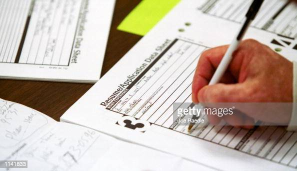 A person looking for a new job fills out a resume form February 1 2001 at the Texas Workforce Center in Austin TX The Texas Workforce Commission is...