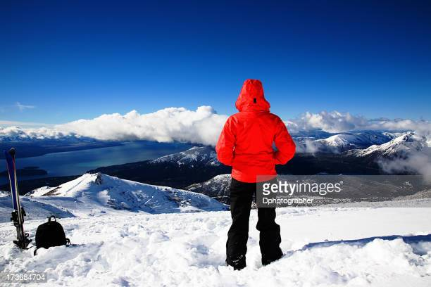 Person looking out over the snowy mountains