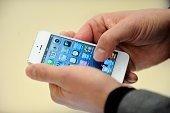 A person looks at an iPhone 5 during the opening of a new Apple store on November 15 2012 in SaintHerblain western France AFP PHOTO / JEANSEBASTIEN...