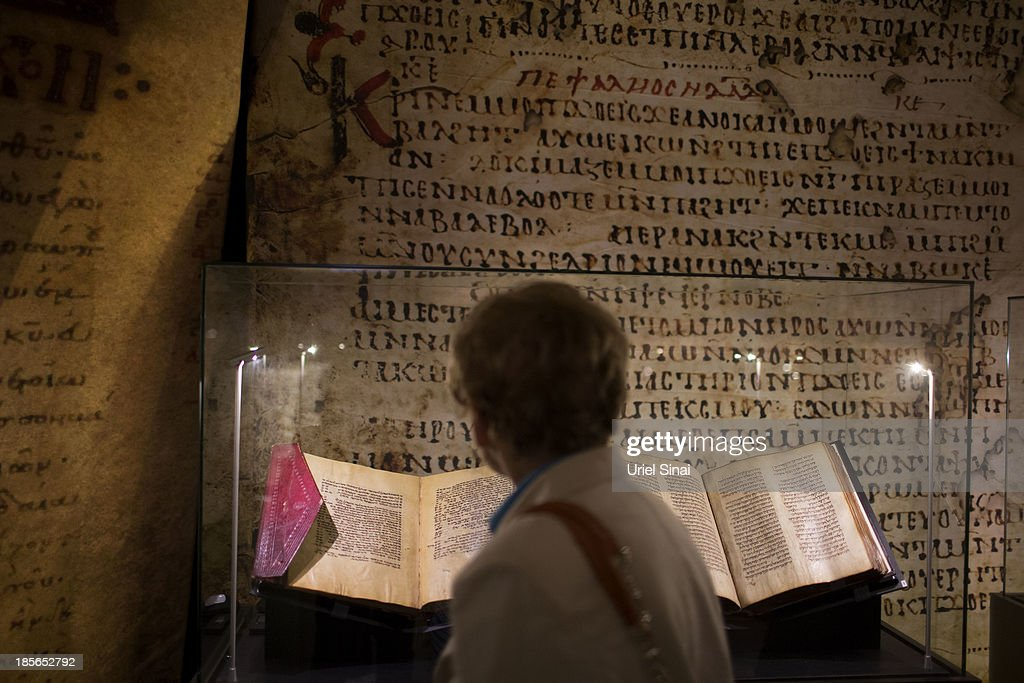 A person looks at ancient biblical manuscripts displayed at the 'Book of Books' exhibition in the Bible Lands Museum on October 23, 2013 in Jerusalem, Israel. The exhibition contains more than 200 of the rarest biblical manuscripts, including original fragments from the Septuagint and the earliest New Testament Scriptures. This exhibition opened in Israel before heading to the Vatican and ends in Washington D.C, where it will be permanently displayed.