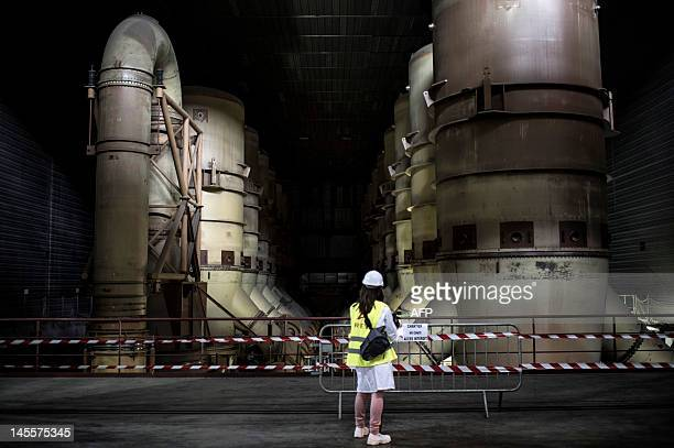 A person looks at centrifuge uraniumenrichment engines on May 31 2012 in SaintPaulTroisChateaux southeastern France in the Eurodif SA/George Besse 1...