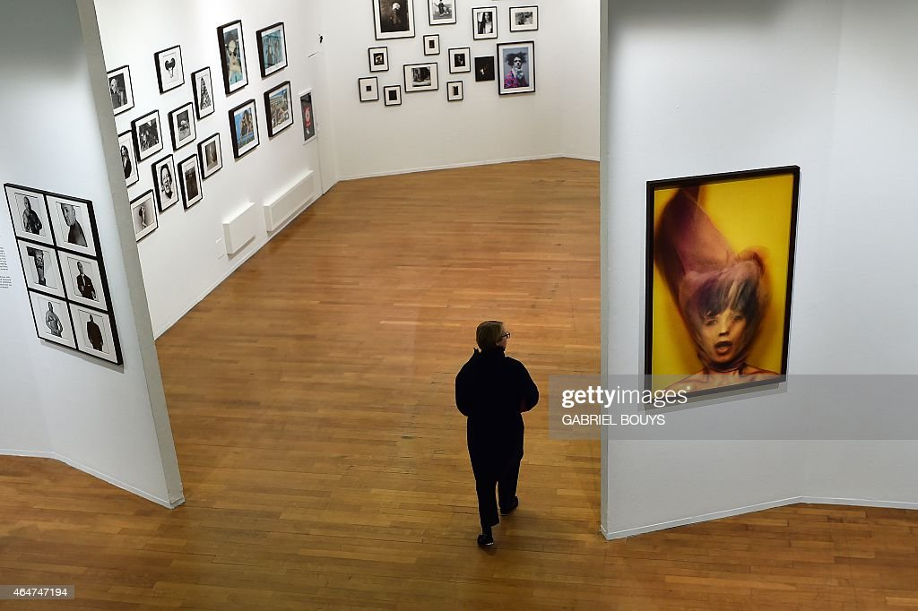 A person looks at pictures by British photographer <a gi-track='captionPersonalityLinkClicked' href=/galleries/search?phrase=David+Bailey+-+Photographer&family=editorial&specificpeople=216323 ng-click='$event.stopPropagation()'>David Bailey</a> during the private preview of the exhibition 'Stardust' on February 28, 2015 in Milan. The show will run from March 1st to June 2, 2015 at the PAC museum (Contemporary Art Pavillon) in Milan.