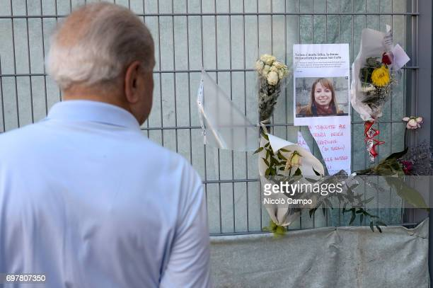 A person looks at sign and flowers in memory of Erika Pioletti who has died on June 16 from injuries sustained at the Champions League final stampede...