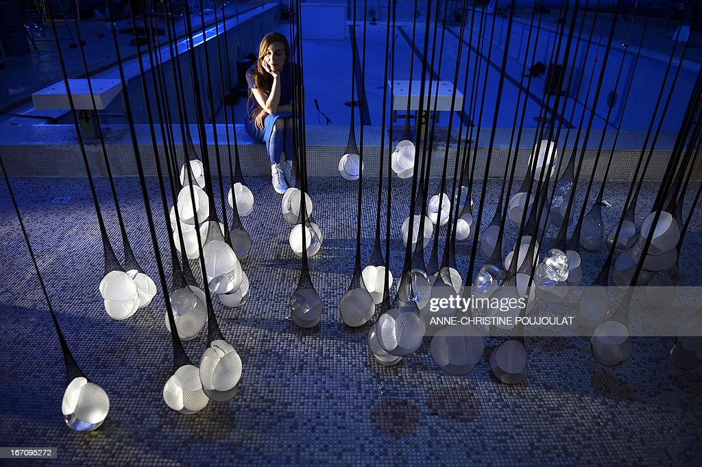 A person looks at the art creation 'PIP Show' by French artist Camille Lorin made with fishnet stockings containing breast implants from the Poly Implant Prothèse (PIP) company on April 19, 2013 at La piscine de Frais-Vallon in Marseille, southern France, during an exhibition presented as part of the Marseille-Provence European Capital of Culture event. The trial of five executives of breast implant company PIP, including its founder Jean-Claude Mas, opened in the French city of Marseille on April 17, 2013.